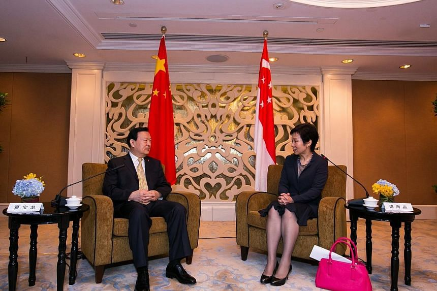 Minister in the Prime Minister's Office Grace Fu met Zhejiang Party Secretary Xia Baolong at the sidelines of 10th Singapore-Zhejiang Economic and Trade Council meeting today. -- PHOTO: INTERNATIONAL ENTERPRISE SINGAPORE