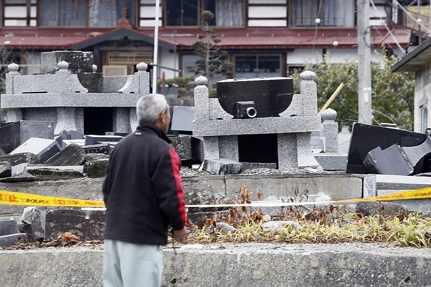 IN JAPAN: Damaged gravestones after a 6.7-magnitude earthquake hit Hakuba, some 300km north-west of Tokyo, in Nagano prefecture. At least 39 people were injured in the quake that struck last Saturday night. IN CHINA: A village school in Kangding Coun