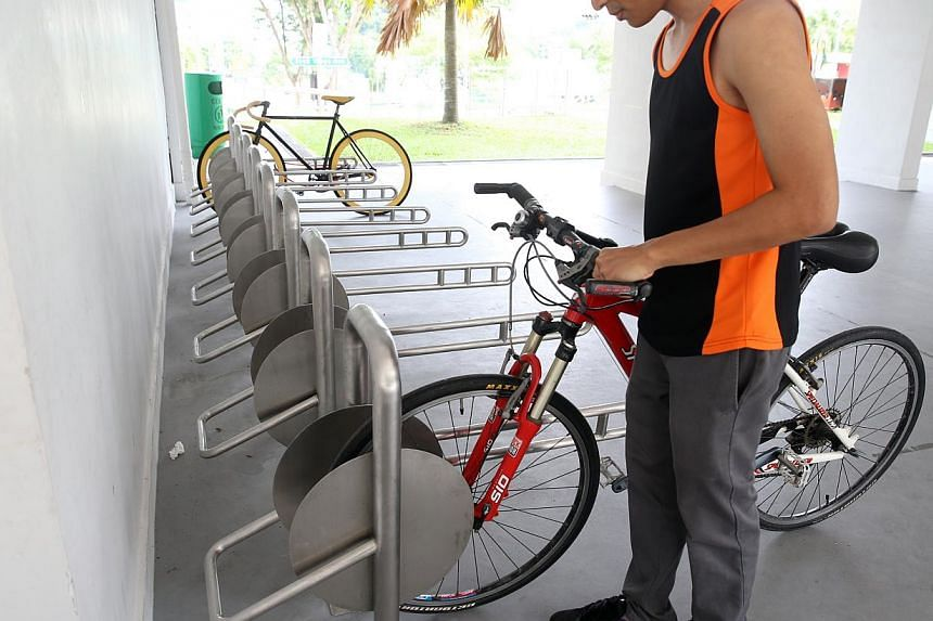 The new design allows cyclists to lock the frame and both wheels of the bicycle to the rack.
