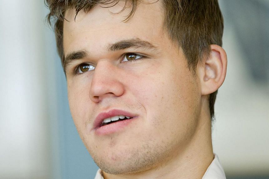 Norwegian prodigy Magnus Carlsen retained his title as World Chess Champion on Sunday, defeating rival Viswanathan Anand for the second year in a row. -- PHOTO: AFP