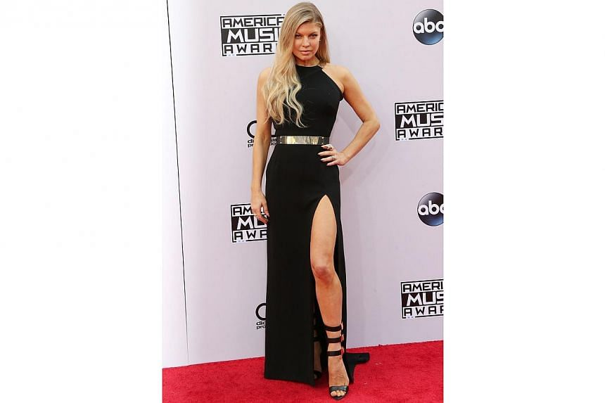 Singer Fergie does toning exercises and she just wants you to know.-- PHOTO: AFP