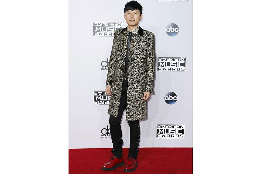Chinese singer Zhang Jie is one of the few people who dressed for winter. No one briefed him that on the red carpet in America, it is always summer. -- PHOTO: REUTERS