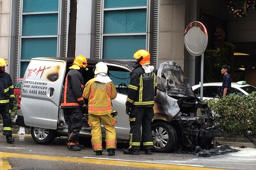 A van caught fire outside Paragon Shopping Centre on Orchard Road on Monday. No one was injured. -- ST PHOTO: NG SOR LUAN