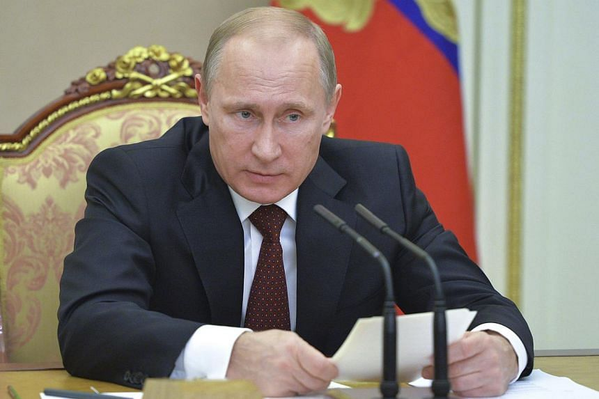 Russian President Vladimir Putin chairs a meeting of the Security Council at the Kremlin in Moscow on Nov 20, 2014. -- PHOTO: REUTERS