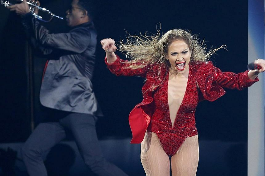 """Jennifer Lopez performs """"Booty"""" during the 42nd American Music Awards in Los Angeles, California on Nov 23, 2014. -- PHOTO: REUTERS"""