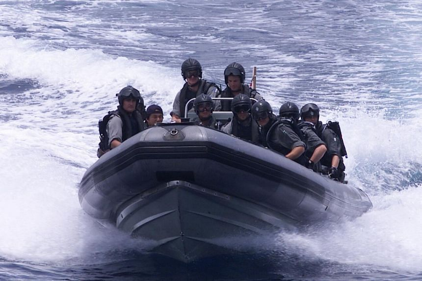 Joint operations in the Strait of Malacca to counter piracy.--PHOTO: ZAOBAO