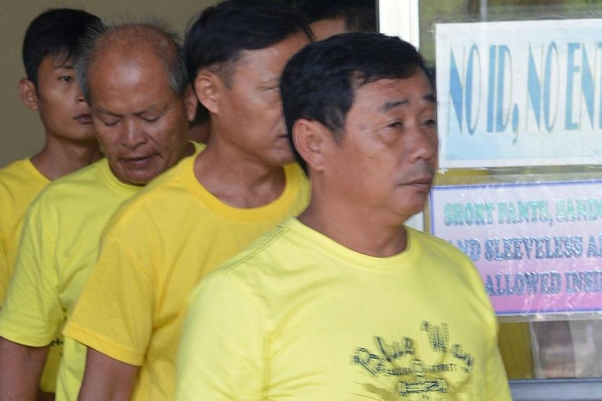 A group of Chinese fishermen leave a court in Puerto Princesa, Palawan island on Nov 24, 2014, after they were found guilty of poaching.China said on Tuesday that the fines imposed by a court in the Philippines on nine Chinese fishermen for cat