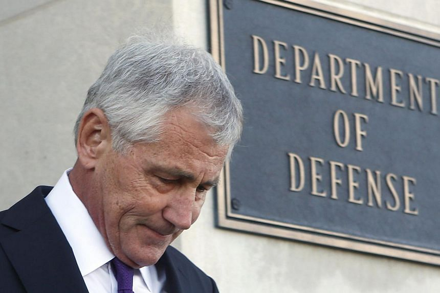 US Secretary of Defense Chuck Hagel walks out to welcome New Zealand's Minister of Defence Gerry Brownlee at the Pentagon in Washington on Nov 24, 2014. -- PHOTO: REUTERS