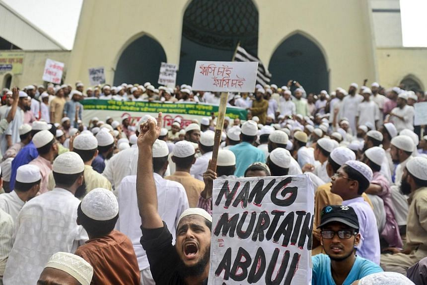 Activists of a Bangladeshi Islamic political group protest against Abdul Latif Siddique, the then telecommunications minister, after his criticism of the Muslim pilgrimage of Hajj, in Dhaka on Oct 2, 2012.Mr Siddique surrendered to Bangladesh p