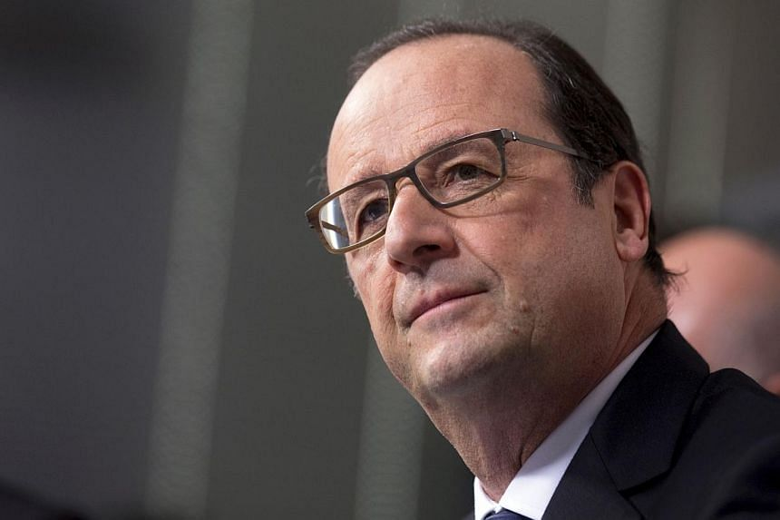 """French President Francois Hollande on Tuesday delayed the controversial delivery of a high-tech warship to Russia """"until further notice"""" over the Ukraine crisis. -- PHOTO: AFP"""