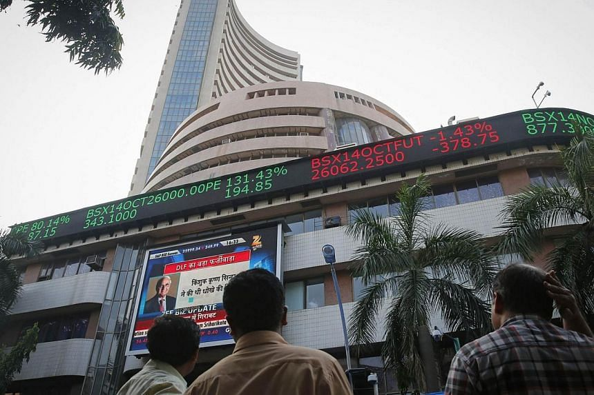 People watch a large screen displaying India's benchmark share index on the facade of the Bombay Stock Exchange (BSE) building in Mumbai on Oct 16, 2014.US investors, buoyed by optimism about India's economy and booming stock market, have been