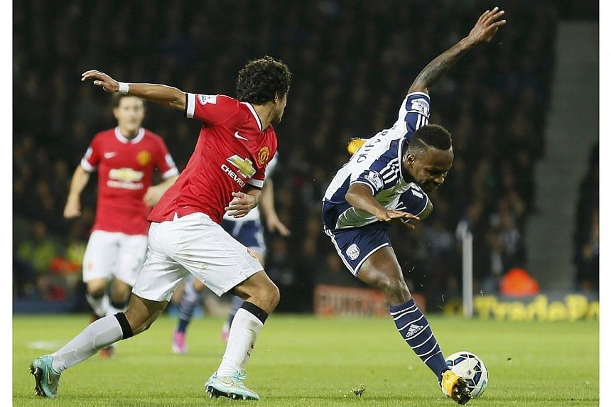Saido Berahino (right) of West Bromwich Albion is tackled by Rafael of Manchester United during their English Premier League soccer match at The Hawthorns in West Bromwich on Oct 20, 2014.Rising English football star Saido Berahinohas bee