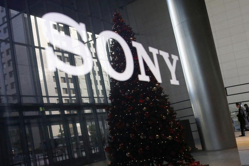 The logo of Sony Corp and a Christmas tree are reflected on the company's 4K television set at the company's headquarters in Tokyo on Nov 18, 2014. Sony has decided not to renew a multi-million-dollar sponsorship contract with world football gov