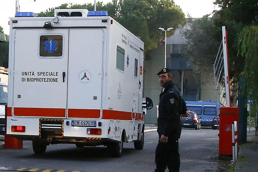 An ambulance carrying an Italian doctor, who contracted Ebola while working in Sierra Leone, arrives at the Lazzaro Spallanzani infectious diseases institute in Rome on Nov 25, 2014.A doctor who has become the first Italian to contract Ebola ar