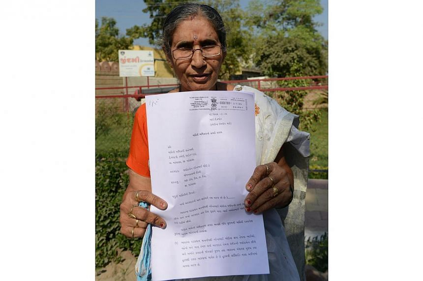Ms Jashodaben Modi, 62, who lives in the western state of Gujarat, said she had filed a petition to find out why she has been given security cover since Mr Modi was elected in May. -- PHOTO: AFP