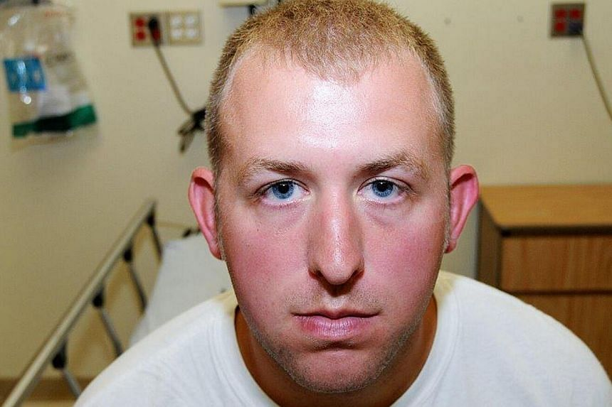 Police officer Darren Wilson's photo taken shortly after the Aug 9, 2014 shooting of Michael Brown. -- PHOTO: REUTERS