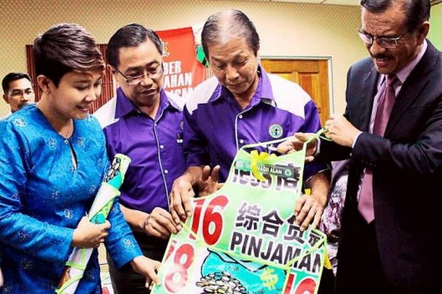 Johor Bahru City Council mayor Datuk Abdul Rahman Mohamed Dewam said the council would stitch aprons out of1,500kg of loan sharks' canvas banners whichits enforcement unit took down in the first 10 months of this year alone. -- THE STAR/A