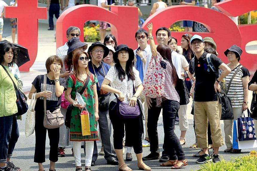 A group of Japanese tourists at a local attraction on Feb 8, 2014. Customer satisfaction for the food and beverage (F&B) and tourism sectors here took a plunge this year, according to findings from the Customer Satisfaction Index of Singapore. --