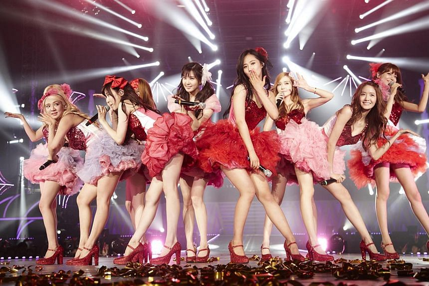K-pop group Girls' Generation performing in Seoul. Chinese e-commerce giant Alibaba is planning a major investment worth at least 100 billion won (S$120 million) in South Korea's SM Entertainment, the agent for the likes of Super Junior, EXO and Girl