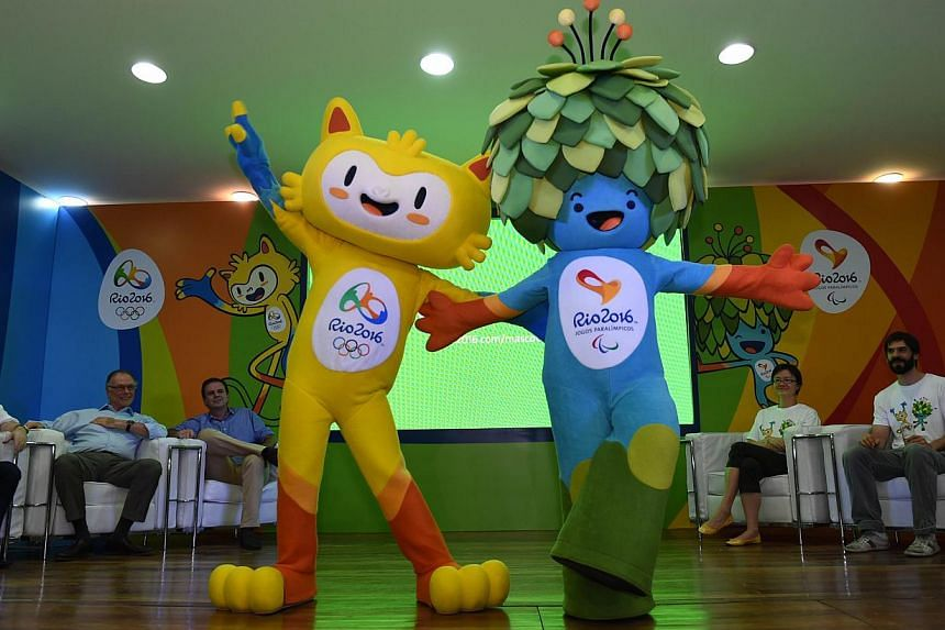 The new mascots for the Rio 2016 Olympic Games (left) and the Rio 2016 Paralympic Games during their presentation in Rio de Janeiro on Nov 24, 2014. -- PHOTO: AFP