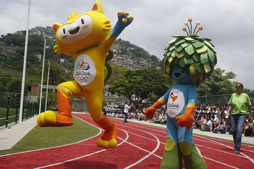 The new mascots for the Rio 2016 Olympic Games (left) and the Rio 2016 Paralympic Games are presented at the Ginasio Experimental Olimpico Juan Antonio Samaranch in Rio de Janeiro, Brazil, on Nov 24, 2014. -- PHOTO: AFP