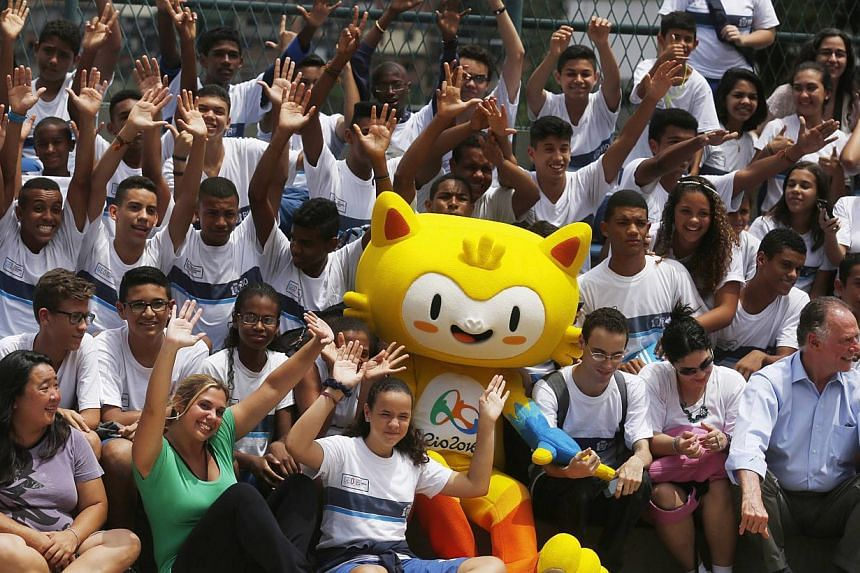 The unnamed mascot of the Rio 2016 Olympic Games is pictured among children during its presentation in Rio de Janeiro on Nov 24, 2014. -- PHOTO: REUTERS