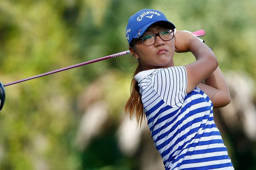 Lydia Ko of New Zealand plays a shot on the 17th hole during the final round of the CME Group Tour Championship at Tiburon Golf Club on Nov 23, 2014 in Naples, Florida. -- PHOTO: AFP