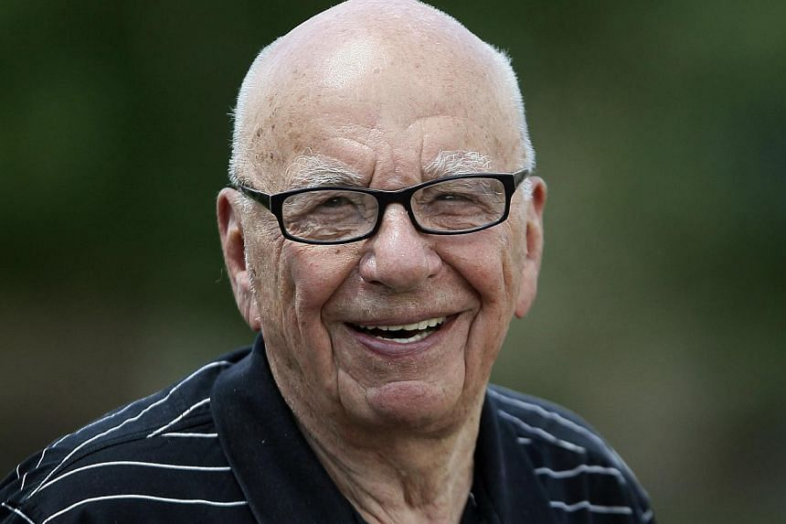 Sun owner Rupert Murdoch smiles during a visit to Sun Valley, Idaho in this file photo taken in July, 2014. -- PHOTO: REUTERS