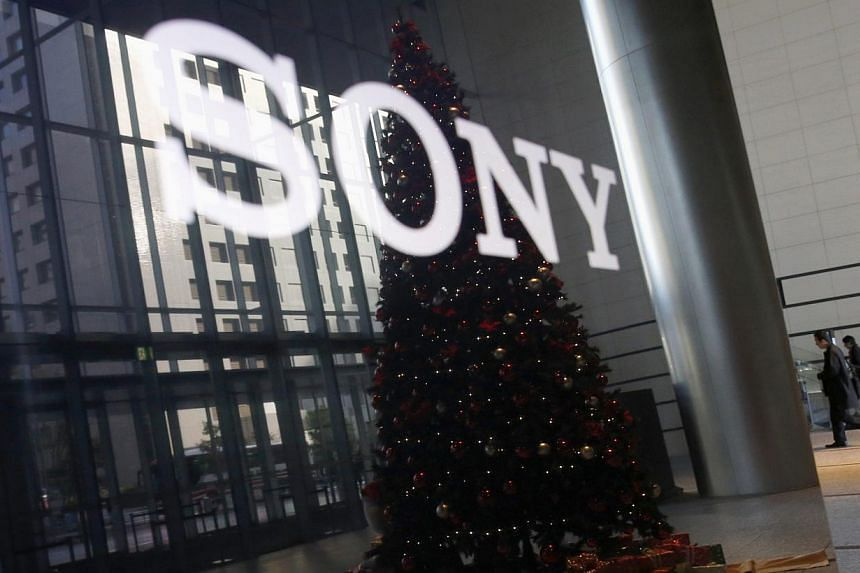 The Sony logo and a Christmas tree are reflected on the company's 4K television set at the company's headquarters in Tokyo on Nov 18, 2014. Sony said it is aiming to garner up to US$11 billion (S$14.3 billion) in revenue from its movie business in th