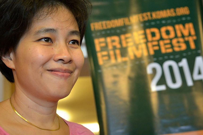 """Director Tan Pin Pin at the screening of her film To Singapore With Love, at the Freedom Film Fest in Johor Baru on Sept 19, 2014. The show was given a """"Not Allowed for All Ratings"""" classification by the MDA in Singapore. -- ST PHOTO: KUA CHEE SI"""