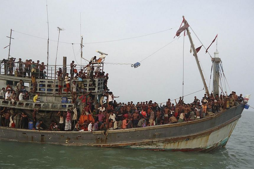 Suspected human trafficking victims crammed on a Thai trawler, which was rescued by the Bangladesh Coast Guard on June 11, 2014. The 2014 Global Slavery Index estimated that almost 36 million people around the world are in some form of slavery. --PHO