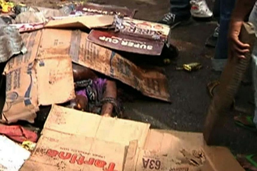 A screen grab taken from a video released by TVC News shows the body of a women killed in a twin bomb blasts in a market in the northeast Nigerian city of Maiduguri on Nov 25, 2014.More than 45 people were killed when two female suicide bombers