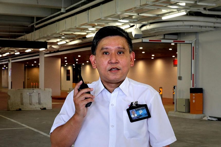 Manpower correspondent Toh Yong Chuan goes undercover as a security guard. -- ST PHOTO:CHEW SENG KIM