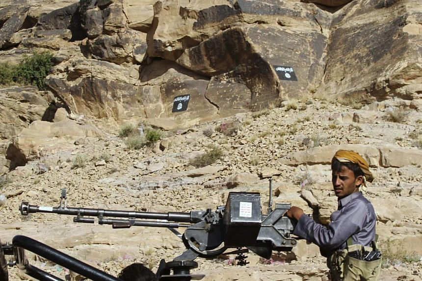 A Shi'ite Houthi manning a weapon on the back of a patrol truck travelling on a road in Almnash, the main stronghold of Ansar al-Sharia, the local wing of Al-Qaeda, on Nov 22, 2014. -- PHOTO: REUTERS