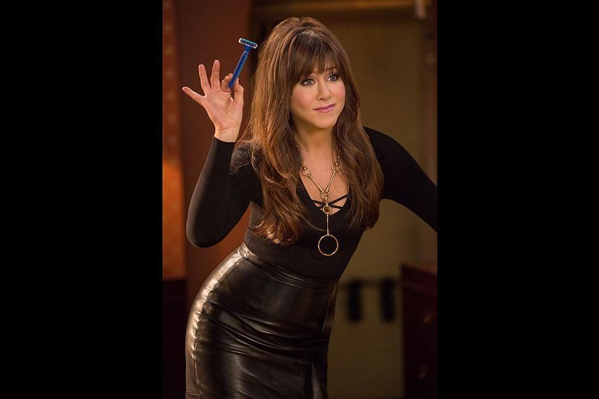 Rom-com queen Jennifer Aniston loves doing comedy, such as her role as an in-your-face nymphomaniac dentist (above) in Horrible Bosses 2. -- PHOTO: WARNER BROS