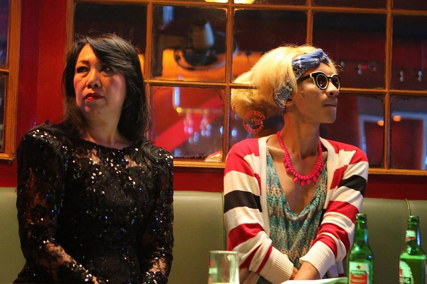 Mrs Surya (Dayu Wijanto, left, with an actor playing a club patron), a wealthy widow, discovers her late husband's disturbing secret. -- PHOTO: SINGAPORE INTERNATIONAL FILM FESTIVAL