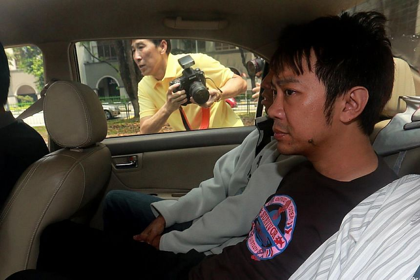 Yang Yin is seen in a police car on Nov 5, 2014. The former China tour guide, accused of manipulating a wealthy widow into making himself her guardian for his personal gain, no longer has any say over her welfare and finances. -- ST PHOTO: WONG KWAI