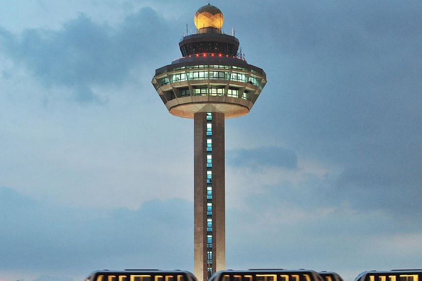 The Changi Airport control tower. This year, Changi Airport handled 44.58 million passengers, a 1 per cent growth over the same period last year. -- PHOTO: ST FILE