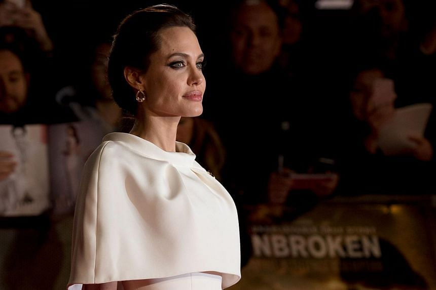 Angelina Jolie poses on the red carpet for the UK premiere of the film Unbroken at Leicester Square in London on Nov 25, 2014. -- PHOTO: AFP