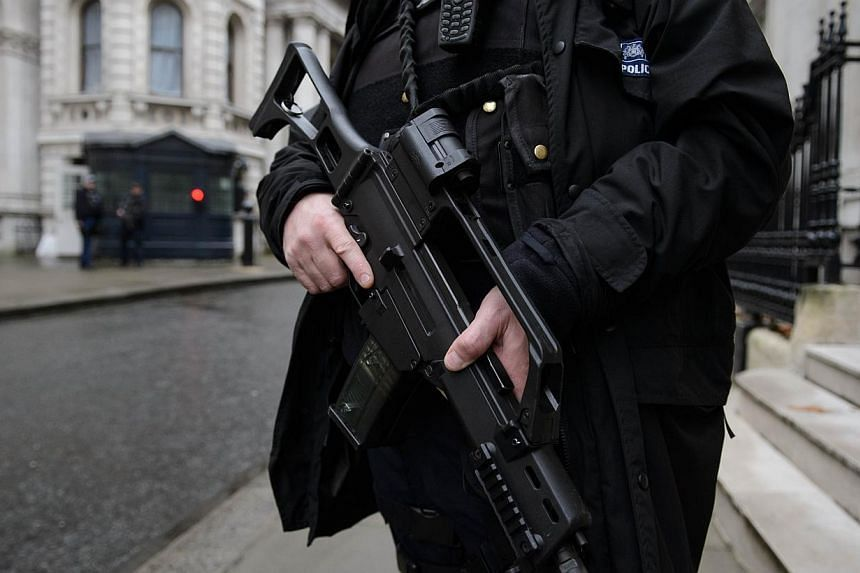 An armed police officer stands guard in Downing Street, central London, on Nov 26, 2014. British Muslim rights groups and ordinary faithful said they felt singled out by a tough new anti-terror law unveiled on Wednesday, labelling the planned legisla