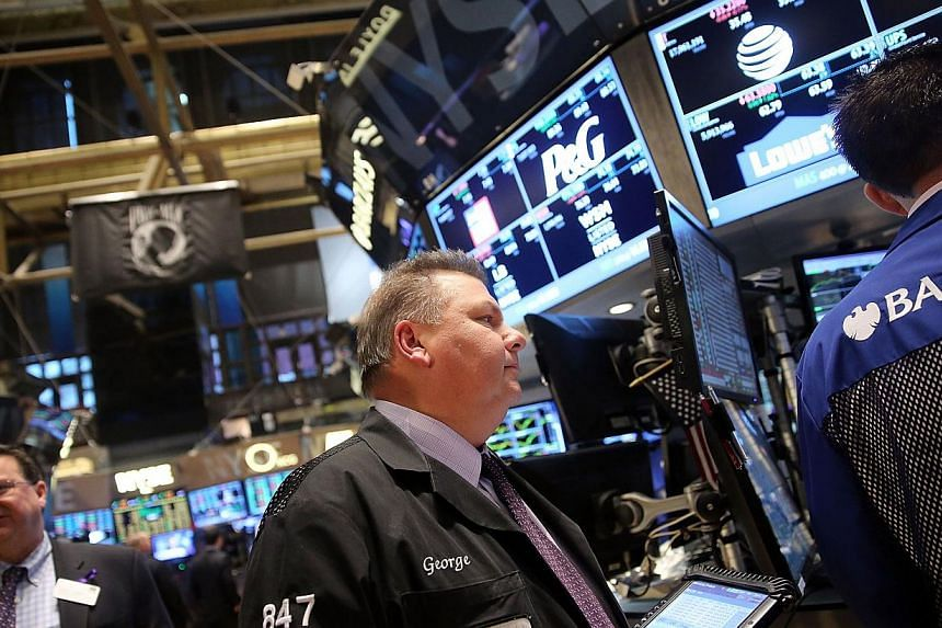 Traders work on the floor of the New York Stock Exchange in New York City on Nov 21, 2014. -- PHOTO: AFP