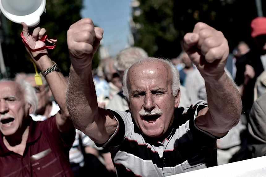 Pensioners demonstrate on Oct 2, 2014 in the centre of Athens against the Greek government's economic measures. -- PHOTO: AFP