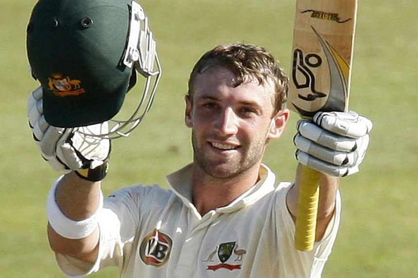 Australia's Phil Hughes celebrates his century during the third day of the second cricket test match against South Africa in Durban in this March 8, 2009 file photo.The manufacturer of the helmet worn by Phil Hughes said Tuesday he was not wear