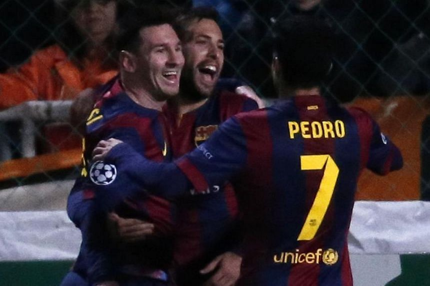 Barcelona's Argentinian forward Lionel Messi (left) celebrates with his teammates after scoring a goal during their UEFA Champions League football match against Apeol at the Neo GSP Stadium in the Cypriot capital, Nicosia, on Nov 25, 2014. -- PHOTO: