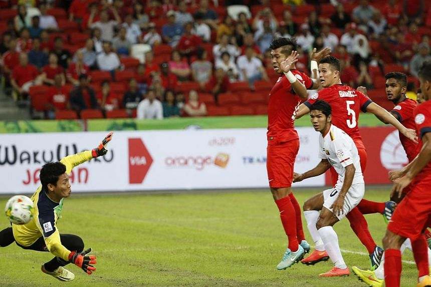 Lions left-back Shaiful Esah's (not in picture) free-kick eluding everyone including the goalkeeper as the ball finds its way into the back of the net in Singapore's AFF Suzuki Cup match against Myanmar at the National Stadium onNov 26, 2014. -