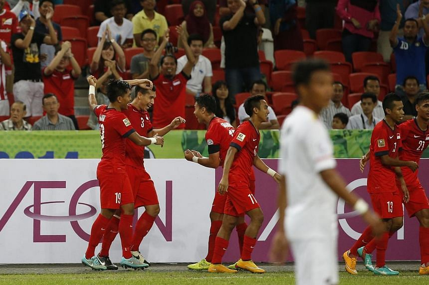 Lions left-back Shaiful Esah (second from left) celebrates with teammates after scoring a free kick in their AFF Suzuki Cup match against Myanmar at the National Stadium on Nov 26, 2014.-- ST PHOTO: KEVIN LIM