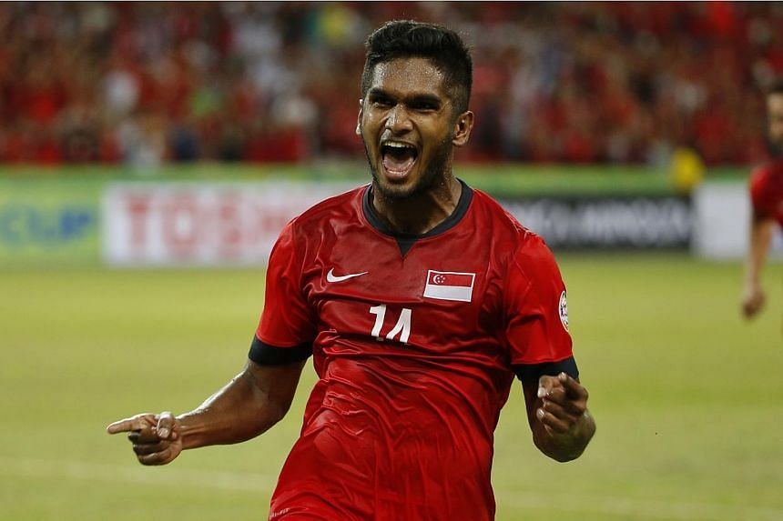 Lions midfielder Hariss Harun celebrates after scoring Singapore's third goal in their AFF Suzuki Cup match against Myanmar at the National Stadium on Nov 26, 2014. -- ST PHOTO: KEVIN LIM