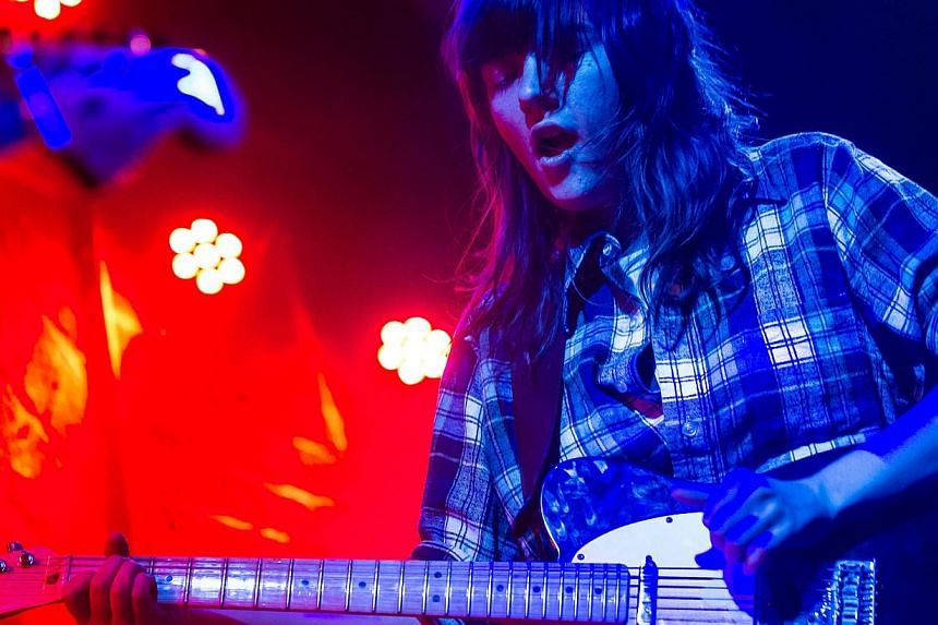 Australian singer and guitarist Courtney Barnett performs in concert at the Chelsea club in Vienna on Nov 23, 2014. -- PHOTO: AFP
