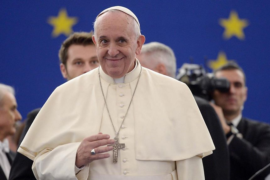 Pope Francis arrives to deliver a speech on Nov 25, 2014, at the European Parliament and the Council of Europe in Strasbourg, eastern France. -- PHOTO: AFP