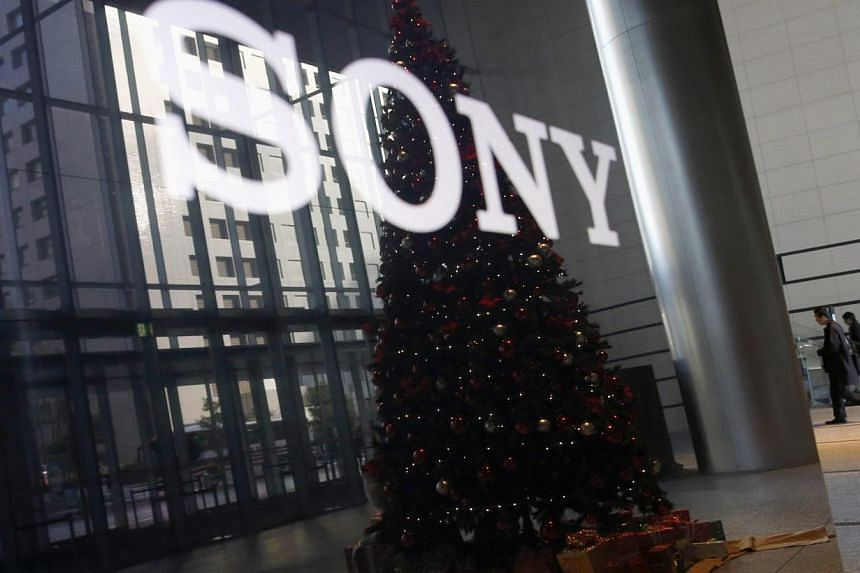 The logo of Sony Corp and a Christmas tree are reflected on the company's 4K television set at the company's headquarters in Tokyo Nov 18, 2014. Its entertainment division said its computer system was down for a second day on Tuesday, following